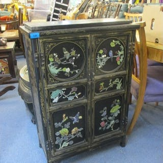 A modern Chinese gilt black lacquered, twin door cabinet wit...