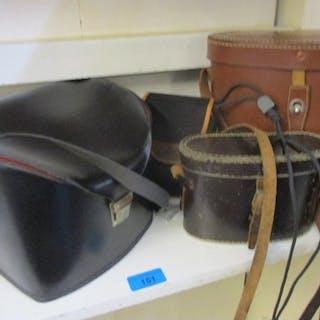 Two pairs of binoculars and vintage cameras