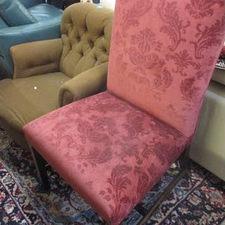 An early 20th century button back armchair, together with an...