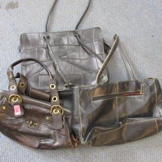 A Stuart Weitzman leather alligator effect handbag and other...