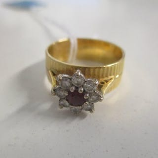 An 18ct gold ring set with a ruby and diamonds 7.1g