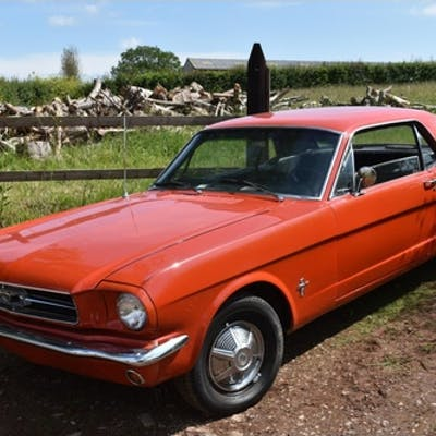 A 1965 Ford Mustang coupé, unregistered, orange. Fords Must...