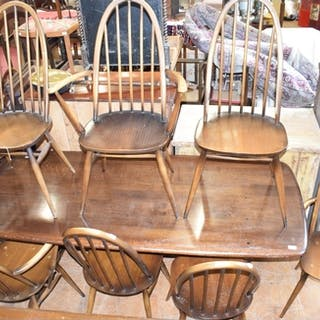 An Ercol oak dining table, and seven matching chairs (3+3) (...