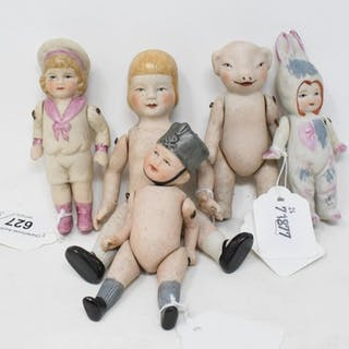 A bisque doll, 15 cm high, and four others similar (5)