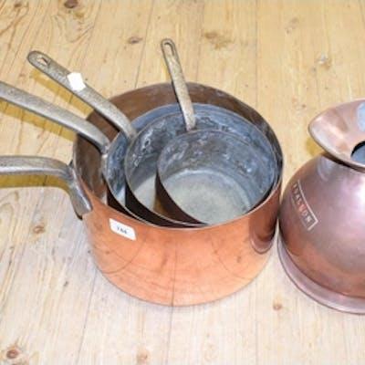 A set of four graduated copper saucepans, a similar harvest ...