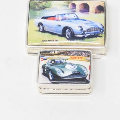 Two silver and enamel car themed pill boxes