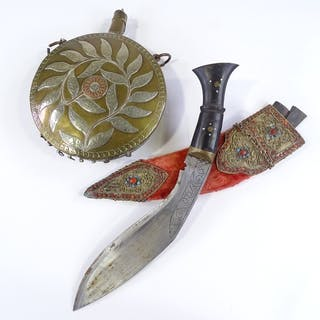 An Eastern ornate kukri knife with coral and turquoise set f