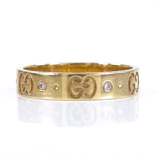 A Gucci 18ct gold diamond wedding band ring, with Gucci embl...