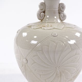 A Chinese white glaze porcelain vase, with relief embossed d...