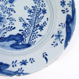 An 18th century blue and white Delft Pottery charger, with h...