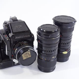 A Mamiya 645 1000s medium format film camera, with power win...