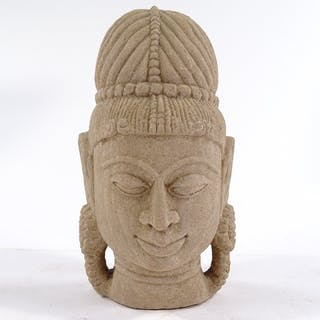 An Indian carved sandstone head, height 16cm