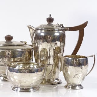 A 4-piece silver tea set, of stepped circular form, by Deaki...
