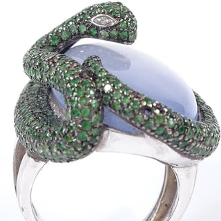 An 18ct white gold chalcedony emerald and diamond figural se...
