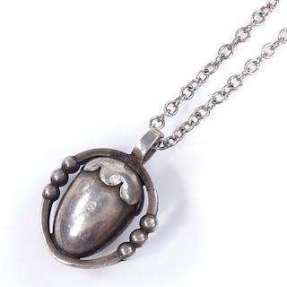 A Georg Jensen Danish sterling silver acorn pendant necklace...