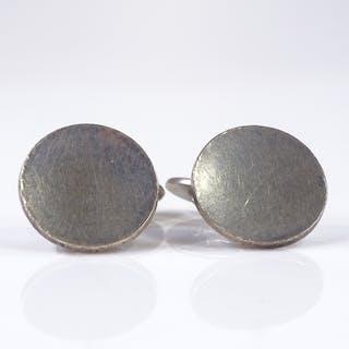 A pair of Danish sterling silver Georg Jensen circular disc ...