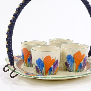 A Clarice Cliff Bizarre Crocus pattern egg set on stand