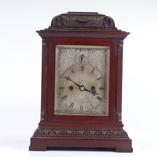 An Edwardian mahogany-cased bracket clock, carved case with ...