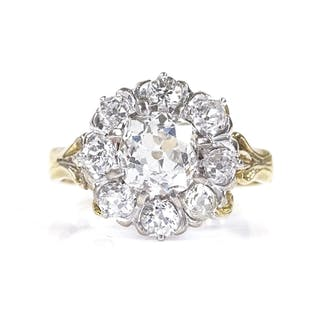An 18ct gold diamond cluster ring, central old mine-cut diam...