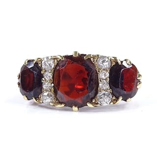 A large 18ct gold garnet and diamond half-hoop ring, with pi...
