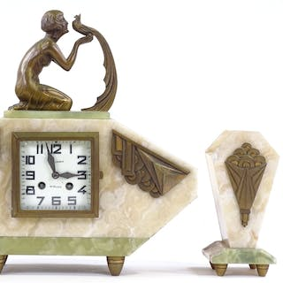 A French Art Deco alabaster and onyx-cased clock garniture, ...