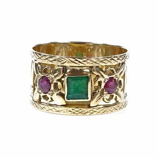 An unmarked gold 3-stone emerald and ruby band ring, with pi...