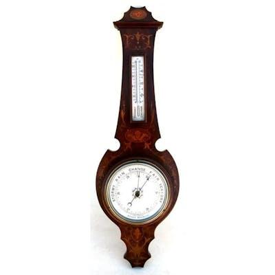An Edwardian inlaid mahogany wall mounted aneroid barometer ...