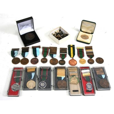 A collection of 19 Shooting Medals and Medallions together w...