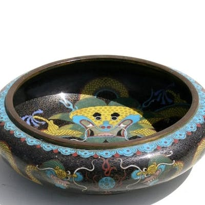 A Chinese cloisonne shallow bowl decorated with scrolling dr...