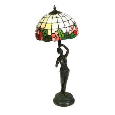 A figural bronzed table lamp with Tiffany style shade, 75cms...