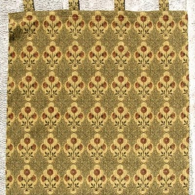An Arts & Crafts style textile wall hanging decorated wi...
