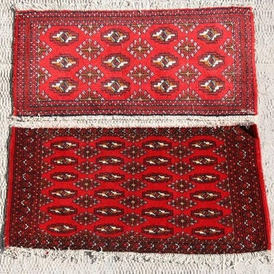 Two similar Persian Baluch woollen handmade rugs with geomet...