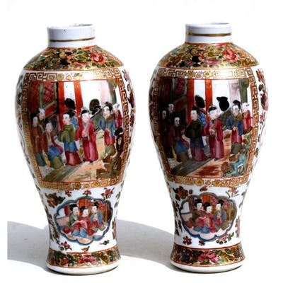 A pair of Chinese Canton Export famille rose vases decorated...