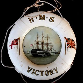 A painted wooden life belt design 'HMS Victory' frame contai...