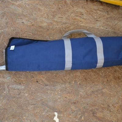 Blue canvas bag with fishing equipment inc gaff