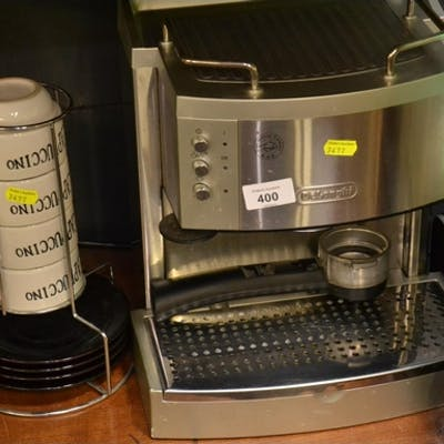 Delonghi Espresso machine + cups and saucers