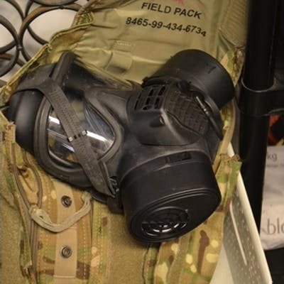 Gas mask in military field pack
