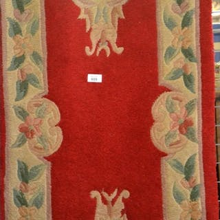 Long red Chinese runner rug