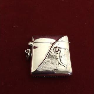 A modern silver vesta, stamped sterling, with golfing decor...
