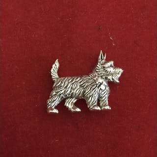 A silver brooch, in the form of a Scottie dog, with ruby ey...