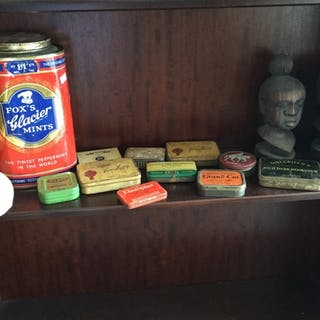 A mixed lot of vintage tins, pair of African carved hardwoo...