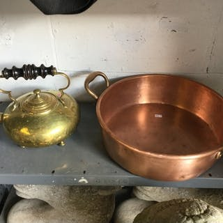 A copper and brass two handled pan, together with a brass k...
