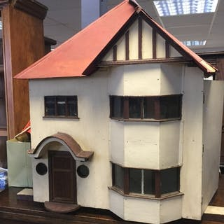 A 1940's dolls house, designed as a detached house, opening...