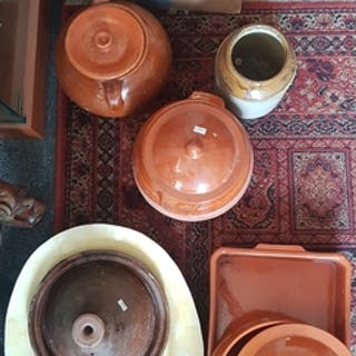 A quantity of terracotta and stoneware cooking pots -