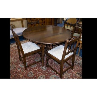 Dark Wood Drop Leaf Dining Table Of Plain Form With X Frame