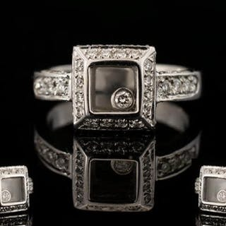An 18ct White Gold And Diamond Set Chopard Style Floating Di...