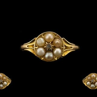 An Early 19thC 18ct Gold Pearl Ring set with a central rose ...