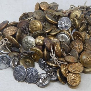 A large collection of Military buttons in tin.