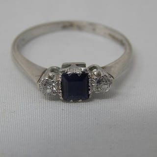 Hallmarked Platinum Ring Inset with a Central Sapphire & Fla...