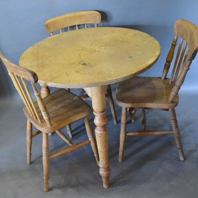 A Pine Circular Table with Turned Legs, together with three ...